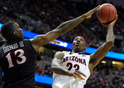 Arizona forward Rondae Hollis-Jefferson (23) shoots over San Diego State forward Winston Shepard (13) during the first half in a regional semifinal of the NCAA men's college basketball tournament, Thursday, March 27, 2014, in Anaheim, Calif.