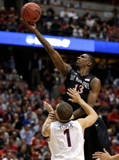 San Diego State forward Winston Shepard (13) drives past Arizona guard Gabe York (1) during the first half in an NCAA men's college basketball tournament regional semifinal, Thursday, March 27, 2014, in Anaheim, Calif. (AP Photo/Jae C. Hong)