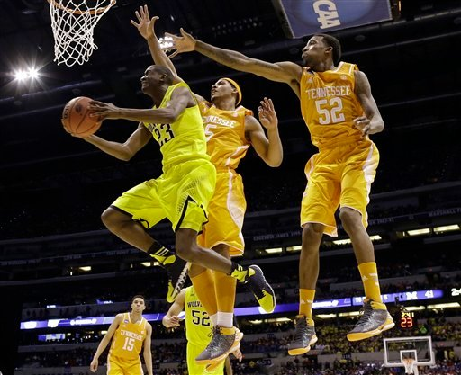 Michigan's Caris LeVert (23) shoots past Tennessee's Jarnell Stokes (5) and Jordan McRae (52) during the first half of an NCAA Midwest Regional semifinal college basketball tournament game March 28, 2014, in Indianapolis. (AP Photo/David J. Phillip)