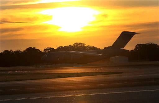 Royal Australia Air Force C-17 lands at RAAF Base Pearce to deliver a Sea Hawk helicopter to help with the search for the missing Malaysia Airlines Flight MH370, in Perth, Australia March 28, 2014. (AP Photo/Rob Griffith)