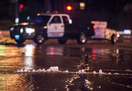 Water bubbles up through the pavement along Gilbert Street just south of Rosecrans in Fullerton Friday night March 28, 2014 following an 5.1 earthquake.