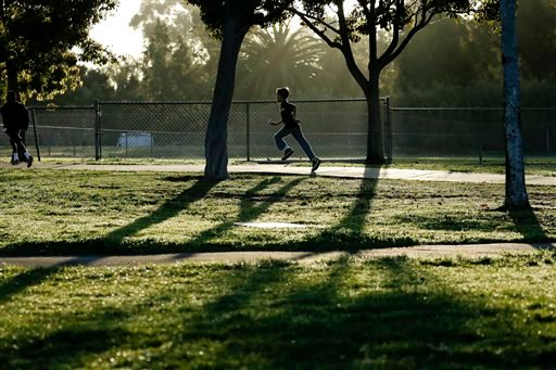In this March 14, 2014 picture, students take part in an early morning running program at an elementary school in Chula Vista, Calif. (AP Photo/Gregory Bull)