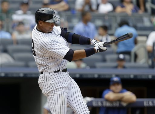 In a Aug. 20, 2013 file photo, New York Yankees' Alex Rodriguez singles during the sixth inning of the baseball game against the Toronto Blue Jays at Yankee Stadium in New York.