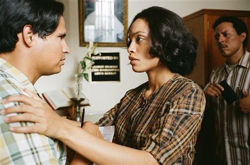 "This photo released by Pantelion Films shows Rosario Dawson, right, as Dolores Huerta, and Michael Pena, left, as Cesar Chavez, in a scene from the film ""Cesar Chavez."""