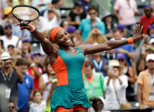Serena Williams celebrates after defeating Li Na, of China, 7-5, 6-1 in the women's final at the Sony Open Tennis tournament, Saturday, March 29, 2014, in Key Biscayne, Fla. (AP Photo/Alan Diaz)