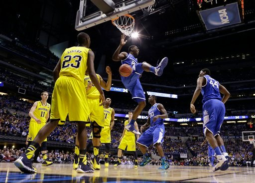 Kentucky's Alex Poythress dunks during the first half of an NCAA Midwest Regional final college basketball tournament game against Michigan Sunday, March 30, 2014, in Indianapolis. (AP Photo/Michael Conroy)