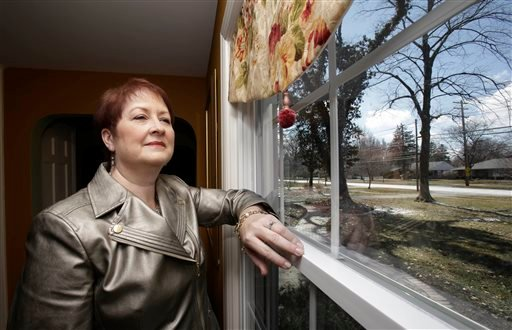 In this Wednesday, March 26, 2014 photo, Heather Britton poses for a photo at her home in Bay Village, Ohio.