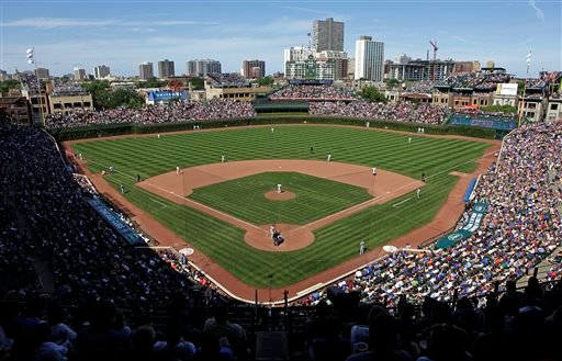 In this Aug. 4, 2013, file photo, the Los Angeles Dodgers play the Chicago Cubs at Wrigley Field in Chicago.