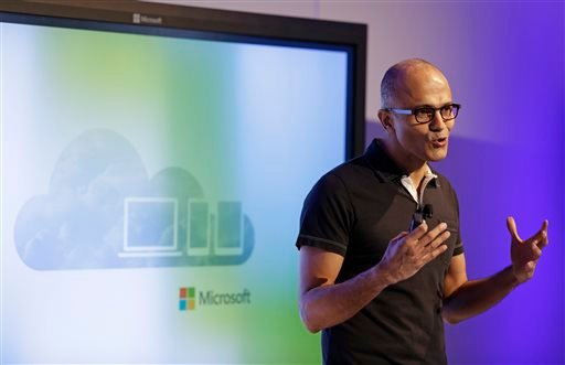 Microsoft CEO Satya Nadella gestures while speaking during a press briefing on the intersection of cloud and mobile computing Thursday, March 27, 2014, in San Francisco.