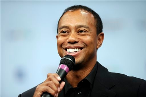 Tiger Woods speaks during a news conference at the Newseum in Washington, Monday, March 24, 2014.