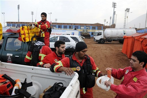 Rescue personnel get their gear ready in the northern town of Iquique, Chile, after magnitude 8.2 earthquake struck the northern coast of Chile, Wednesday, April 2, 2014. (AP)
