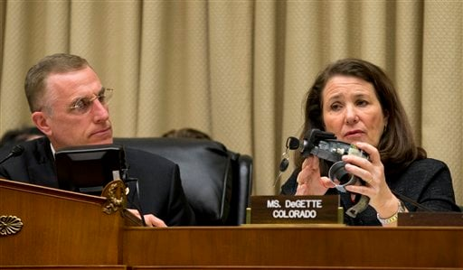 House Oversight and Investigations subcommittee Chairman Rep. Tim Murphy, R-Pa., watches as the subcommittee's ranking member, Rep. Diana DeGette, D-Colo. holds up a GM ignition switch, on Capitol Hill April 1, 2014. (AP Photo/J. Scott Applewhite)