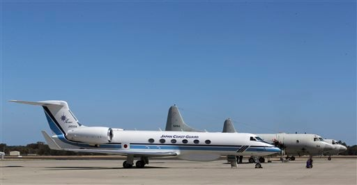 Japan Coast Guard's Gulfstream V, foreground, and two Japan Maritime Self-Defense Force's P-3 Orions sit on the tarmac at RAAF Base Peace in Perth, Australia, Wednesday, April 2, 2014.(AP Photo/Rob Griffith)