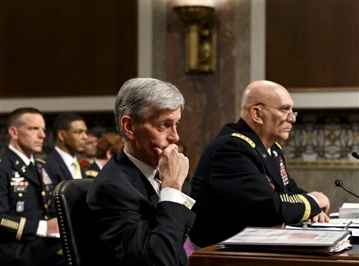 Army Secretary John M. McHugh, left, and Army Chief of Staff Gen Raymond Odierno update members of the Senate Armed Services Committee about the deadly shooting rampage at Fort Hood April 3, 2014 on Capitol Hill. (AP Photo/J. Scott Applewhite)