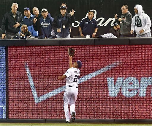 San Diego Padres right fielder Will Venable makes a running catch on a deep drive by Los Angeles Dodgers' A.J. Ellis in the fifth inning of a baseball game Wednesday, April 2, 2014, in San Diego. (AP Photo/Lenny Ignelzi)