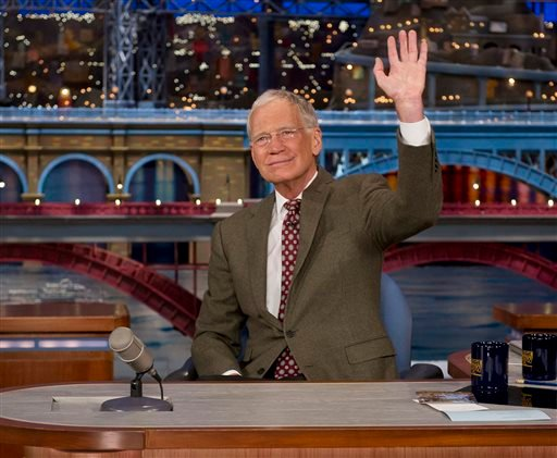 """In this photo provided by CBS, David Letterman, host of the """"Late Show with David Letterman,"""" waves to the audience in New York on Thursday, April 3, 2014, after announcing that he will retire sometime in 2015."""