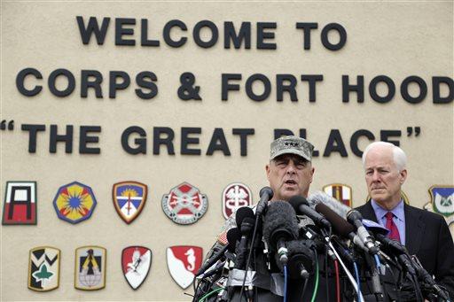 Lt. Gen. Mark Milley, left,and U.S. Sen. John Cornyn, right, talk to the media near Fort Hood's main gate, Thursday, April 3, 2014, in Fort Hood, Texas.