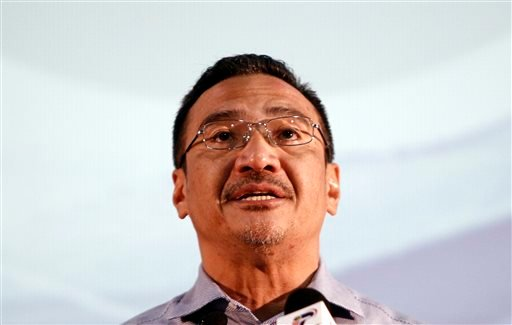 Malaysian acting Transport Minister Hishammuddin Hussein speaks during a press conference for the missing Malaysia Airlines Flight MH370, in Kuala Lumpur, Malaysia, Saturday, April 5, 2014.