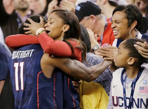 Connecticut guard Ryan Boatright (11) gets a hug from his mother, Tanesha Boatright, after his team defeated Florida 63-53 in an NCAA men's college basketball tournament Final Four semifinal, Saturday, April 5, 2014, in Arlington, Texas.