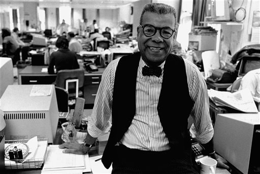 In this Feb. 15, 1984, file photo, newspaper columnist Chuck Stone poses in the newsroom of the Daily News in Philadelphia.