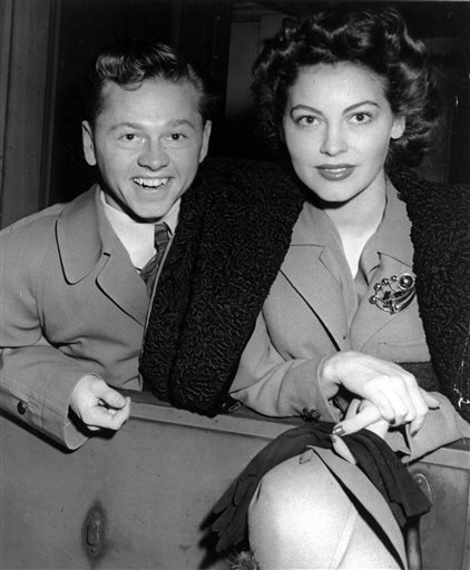 Mickey Rooney and wife, Ava Gardner, arrive in New York in January 1942, en route to Boston where Rooney is to appear at a Red Cross benefit.