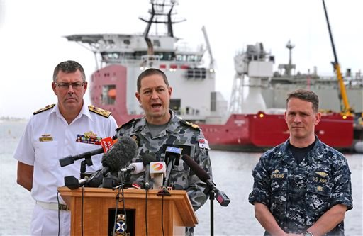 In this Sunday, March 30, 2014 file photo, Royal Australian Navy Commodore Peter Leavy, center, commander of joint task force 658, accompanied by U.S. Navy Captain Mark Matthews, right, and Chief of the Royal Australian Navy Vice Admiral Ray Griggs.