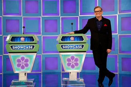 "This 2013 photo released by CBS shows Drew Carey, host of ""The Price is Right,"" on the set in Los Angeles. On Tuesday, April 7, the game show will air its 8,000th episode since it debuted on CBS in 1972."