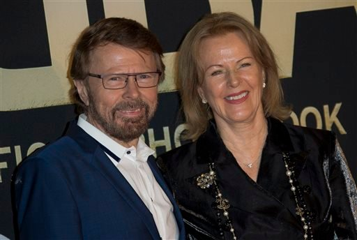 Swedish singer's Bjorn Ulvaeus, left, and Anni-Frid Lyngstad, of the pop group ABBA, pose on the red carpet ahead of the band's International anniversary party at the Tate Modern in central London, Monday, April 7, 2014. (AP)