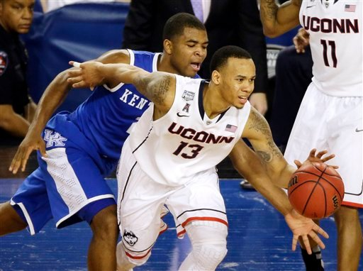 Connecticut guard Shabazz Napier (13) tries to control the ball as Kentucky guard Aaron Harrison (2) defends during the second half of the NCAA Final Four tournament college basketball championship game Monday, April 7, 2014, in Arlington, Texas. (AP)
