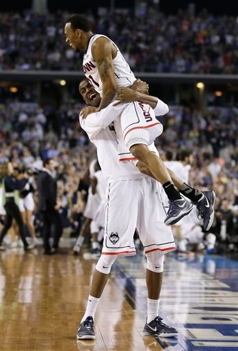 Connecticut guard Ryan Boatright, top, celebrates with a teammate after their 60-54 victory over Kentucky in the NCAA Final Four tournament college basketball championship game Monday, April 7, 2014, in Arlington, Texas. (AP Photo/Charlie Neibergall)