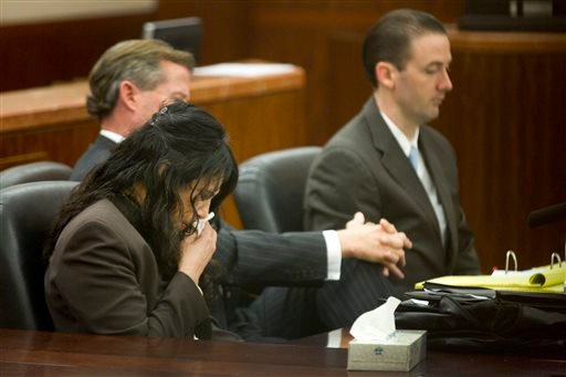 Ana Lilia Trujillo, left, reacts to hearing a 911 call during her trial Tuesday, April 1, 2014, in Houston.