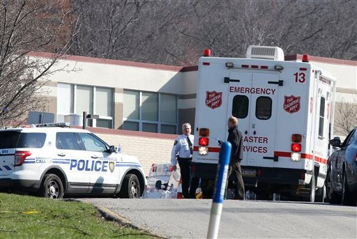 Emergency responders gather in the parking lot of the high school on the campus of the Franklin Regional School District where several people were stabbed at Franklin Regional High School April 9, 2014, in Murrysville, Pa.(AP Photo/Keith Srakocic)