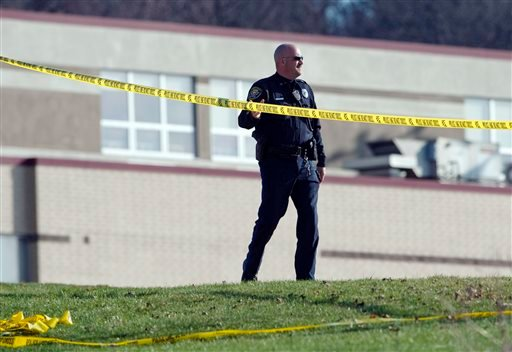 A police officer stands by the scene outside Franklin Regional High School where more then a dozen students were stabbed by a knife wielding suspect on Wednesday, April 9, 2014, in Murrysville, Pa., near Pittsburgh. (AP)