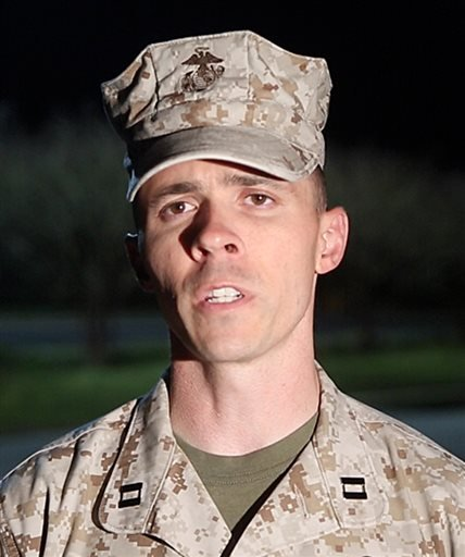 Capt. Joshua Smith, public affairs officer for Marine Corps Installations East, Camp Lejeune, Jacksonville, comments on the recent shooting Tuesday April 8, 2014 at Camp Lejeune. (AP Photo/John Althouse/The Daily News)
