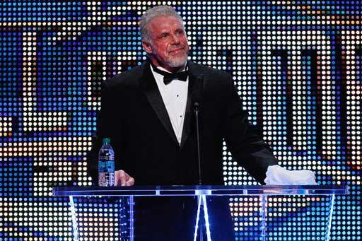 In this April 5, 2014 file photo provided by the WWE, James Hellwig, aka The Ultimate Warrior, speaks during the WWE Hall of Fame Induction at the Smoothie King Center in New Orleans.
