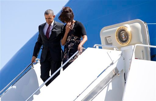 President Barack Obama and first lady Michelle Obama get off Air Force One upon their arrival at Robert Gray Army Air Field in Killeen, Texas, Wednesday, April 9.(AP Photo/Carolyn Kaster)