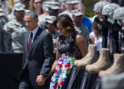 President Barack Obama and first lady Michelle Obama arrive for a memorial ceremony, Wednesday, April 9, 2014, at Fort Hood Texas, for those killed there in a shooting last week. (AP)