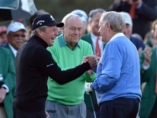 Gary Player, Arnold Palmer, Jack Nicklaus shake hands after hitting ceremonial drives on the first tee during the first round of the Masters golf tournament April 10, 2014 in Augusta, Ga.(AP Photo/Atlanta Journal-Constitution, Curtis Compton)
