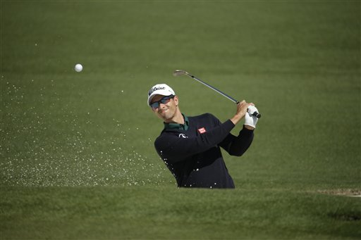 Adam Scott, of Australia, hits out of a bunker on the second fairway during the first round of the Masters golf tournament Thursday, April 10, 2014, in Augusta, Ga. (AP Photo/Chris Carlson)