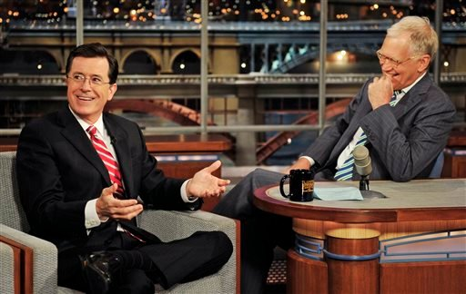 "In this May 3, 2012 photo provided by CBS, Stephen Colbert, left, host of the ""Colbert Report"" on the Comedy Central Network, has a laugh on stage with host David Letterman on the set of the ""Late Show with David Letterman,"" in New York."