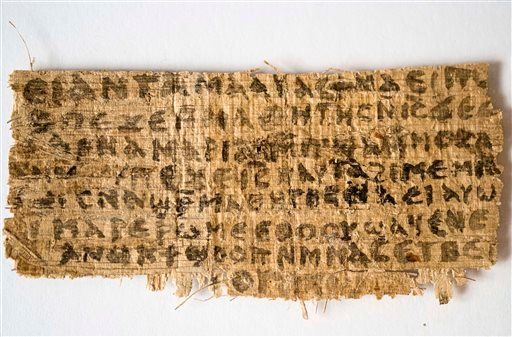 FILE - This Sept. 5, 2012 file photo released by Harvard University shows a fragment of papyrus that divinity professor Karen L. King said is the only existing ancient text that quotes Jesus explicitly referring to having a wife. (AP)