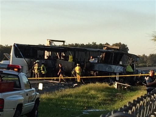 In this photo provided by Andrew Hutchens, authorities work the scene where nine people were killed in a three-vehicle crash involving a bus carrying high school students on a visit to a college, Thursday, April 10, 2014, near Orland, Calif.