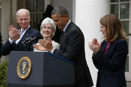 President Barack Obama and Vice President Joe Biden stand with outgoing Health and Human Services Secretary Kathleen Sebelius, second from left, and his nominee to be her replacement, Budget Director Sylvia Mathews Burwell, Friday, April 11, 2014. (AP)