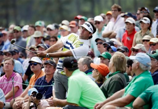 Bubba Watson watches his shot out of the gallery on the 18th hole during the second round of the Masters golf tournament Friday, April 11, 2014, in Augusta, Ga. (AP Photo/Darron Cummings)