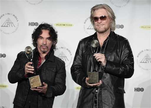 Hall of Fame Inductees John Oates and Daryl Hall appear in the press room at the 2014 Rock and Roll Hall of Fame Induction Ceremony on Thursday, April, 10, 2014, in New York. (Photo by Andy Kropa/Invision/AP)