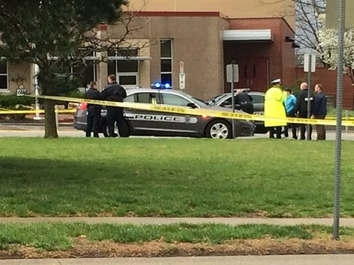 In this photo provided by KSHB41 Action News, authorities respond the Jewish community center after a shooting in Overland Park, Kan., Sunday, April 13, 2014. (AP Photo/KSHB41 Action News)