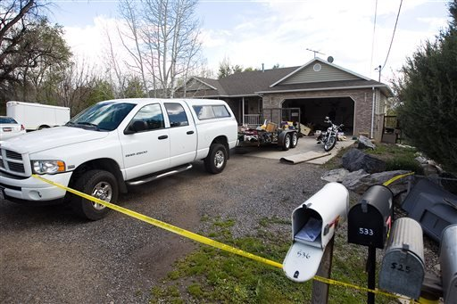 Authorities investigate a crime scene at a house in Pleasant Grove Utah, Sunday, April 13, 2014.