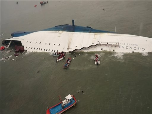 Photo released by South Korea Coast Guard via Yonhap News Agency: South Korean rescue team boats and fishing boats try to rescue passengers of a ferry sinking off South Korea's southern coast April 16, 2014.(AP Photo/South Korea Coast Guard via Yonhap)