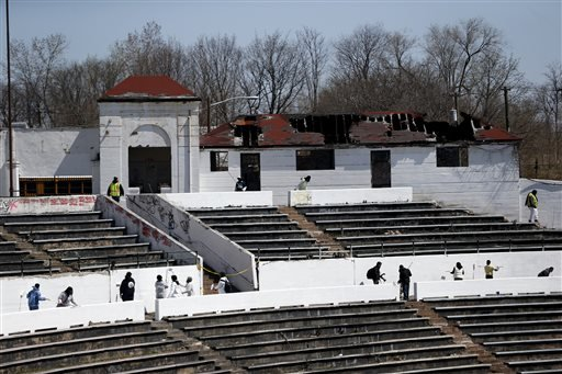 Volunteers paint over graffiti on the walls of Hinchliffe Stadium, Wednesday, April 16, 2014, in Paterson, N.J. (AP)