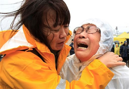 Relatives of a passenger aboard a sunken ferry weep as they wait for news on the rescue operation, at a port in Jindo, South Korea, Thursday, April 17, 2014.(AP Photo/Ahn Young-joon)